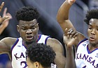 Kansas center Udoka Azubuike (35) and Kansas guard Devonte' Graham (4) try to trap Washington guard David Crisp (1) during the second half, Wednesday, Dec. 6, 2017 at Sprint Center.