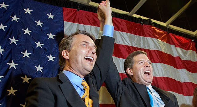 In this file photo from Nov. 4, 2014, Kansas Lt. Gov. Jeff Colyer, left, and Gov. Sam Brownback celebrate after winning re-election at a Kansas Republican Party gathering in Topeka.