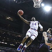 Kansas guard Malik Newman (14) cruises in for a bucket during the first half, Wednesday, Dec. 6, 2017 at Sprint Center.