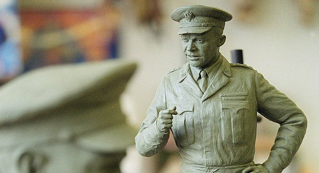 In this file photo from Aug. 23, 2001, a clay maquette of Dwight D. Eisenhower is seen in Lawrence before the sculpting of a 7 1/2-foot bronze statue by Lawrence artist Jim Brothers. Brothers made the sculpture of the former President and five-star general for the National Statuary Hall in the U.S. Capitol. A second 10-foot Eisenhower was sculpted for the National D-Day Memorial in Bedford, Va. The clay bust for the 10-foot version is visible in background at left.