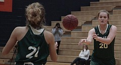 Free State sophomore Haley Hippe (20) passes the ball to junior Mayela Edwards (21) during the Firebirds' 43-31 loss to Blue Valley Northwest on Thursday in the consolation semifinals of the Lady Hawks Basketball Classic at Olathe East.