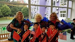 Lawrence Public Schools educators Nicole Corn, left, Darcy Kraus, center, and Jerri Kemble, right, are greeted by Copernic Kindergarten students in this photo from their trip to Shanghai in November 2017. Corn, a kindergarten teacher at Lawrence's Sunset Hill Elementary School, participated in a cultural exchange pilot program with Copernic last year, and, with her colleagues, was invited to share STEM curricula with Chinese teachers and students earlier this fall.