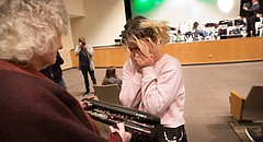 Free State sophomore Harlee Crossett is overcome with emotion as she shows her grandmother Diana Crossett her new Travis James flute that was presented to her through Band of Angels, an organization through Meyer Music, which receives donated instruments that are then refurbished and given to students who meet the qualifications of the program. Crossett and Gabriel Leverette, a Free State junior and trumpet player, were both chosen to receive instruments.