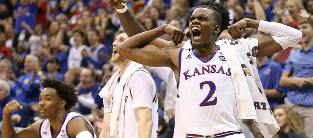 Kansas guard Lagerald Vick (2) flexes after a bucket from reserve guard Chris Teahan during the second half on Friday, Nov. 24, 2017 at Allen Fieldhouse.