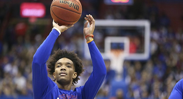 Kansas senior point guard Devonte' Graham throws up a shot in warmups prior to Saturday's game against Arizona State at Allen Fieldhouse.