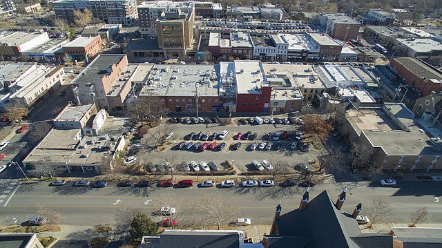As city leaders discuss potential location for a new transit hub, one possible landing spot could be the city parking lot 5, which sits on the east side of Vermont Street between Ninth and 10th streets. Conceptual plans for this location could include a multistory building with room for retail or residential space.