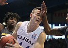 Kansas forward Mitch Lightfoot (44) catches a chop to the face from Arizona State guard Shannon Evans II (11) while pulling in a rebound during the second half, Sunday, Dec. 10, 2017 at Allen Fieldhouse. At left is Arizona State forward Romello White.