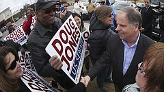 Democratic candidate for U.S. Senate Doug Jones greets supporters and voters outside Bethal Baptist Church Tuesday, Dec. 12, 2017, in Birmingham , Ala. Jones is facing Republican Roy Moore. (AP Photo/John Bazemore)