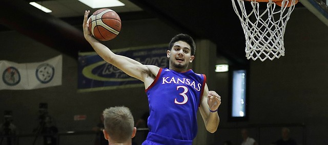 Kansas guard Sam Cunliffe, top, skies for an offensive rebound during an exhibition win against Italy All Star A2, in Seregno, near Milan, Italy, Sunday, Aug. 6, 2017. (AP Photo/Antonio Calanni)