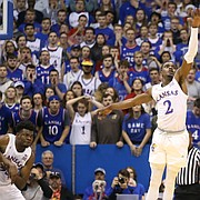 Arizona State guard Shannon Evans II (11) puts a three over Kansas guard Lagerald Vick (2) during the second half, Sunday, Dec. 10, 2017 at Allen Fieldhouse.