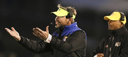 Kansas defensive coordinator Clint Bowen disputes a call during the fourth quarter on Saturday, Nov. 18, 2017 at Memorial Stadium.