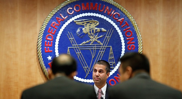 Federal Communications Commission Chairman Ajit Pai takes his seat for an FCC meeting where they will vote on net neutrality, Thursday, Dec. 14, 2017, in Washington. (AP Photo/Jacquelyn Martin)