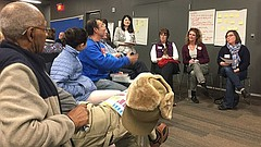 School board members Jill Fincher, second from right, and Vanessa Sanburn, far right, discuss concerns surrounding bullying, safety and mental health with community members during the Lawrence school district's Community Conversation event Thursday, Dec. 14, 2017. The public event, which encouraged parents, staff and other stakeholders to discuss education issues with school board and district representatives, was held at the Lawrence Public Library, 707 Vermont St.