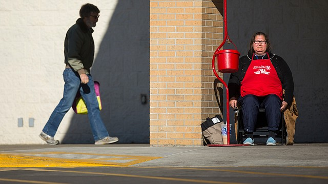 Salvation Army bell ringer Lisa Branch rings from her post on Tuesday, Dec. 12, 2017 at Dillons, 3000 W. Sixth St.. Donations to the Salvation Army are reportedly down for the season.