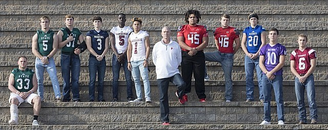 The 2017 Journal-World All-Area football team, from left, Jax Dineen, Free State; Gage Foster, Free State; David Johnson, Free State; Trey Huslig, Veritas Christian; Ekow Boye-Doe, Lawrence; Player of the Year Dante Jackson, Lawrence; Coach of the Year Al Troyer, Tonganoxie; LeeRoi Johnson, Tonganoxie; Dalton Bock, Tonganoxie; Dalton Kellum, Perry-Lecompton; Luke Laskowski, Baldwin; and Carter Neis, Eudora.