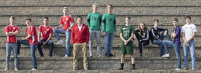 The 2017 Journal-World All-Area boys soccer team, from left, Jens Ahlen, Tonganoxie; Isaiah Frese, Tonganoxie; Bowan Jones, Tonganoxie; Zeb Huseman, Tonganoxie; Coach of the Year Jon Orndorff, Tonganoxie; Player of the Year Charlie Newsome, Free State; Nick Howard, Free State; Evan McHenry, Bishop Seabury; Cole Shupert, Lawrence; Ben Matthews, Lawrence; Blayne Chapman, Baldwin; and Jon Bock, Eudora.