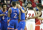 Kansas guard Devonte' Graham (4) huddles up the Jayhawks during the first half, Saturday, Dec. 16, 2017 at Pinnacle Bank Arena in Lincoln, Nebraska.