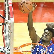 Kansas center Udoka Azubuike (35) puts up a shot over Nebraska center Jordy Tshimanga (32) during the first half, Saturday, Dec. 16, 2017 at Pinnacle Bank Arena in Lincoln, Nebraska.