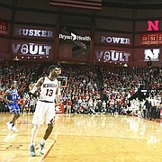Kansas guard Sviatoslav Mykhailiuk (10) puts up a three from the corner over Nebraska forward Isaac Copeland (14) to give the Jayhawks a one point lead with seconds remaining in the game, Saturday, Dec. 16, 2017 at Pinnacle Bank Arena in Lincoln, Nebraska.