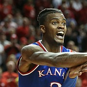 Kansas guard Lagerald Vick (2) throws a pass along the baseline during the second half, Saturday, Dec. 16, 2017 at Pinnacle Bank Arena in Lincoln, Nebraska. In back is Nebraska guard Thomas Allen (12).