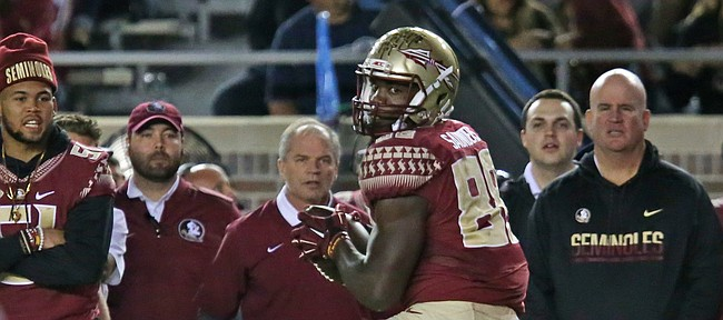 Florida State's Mavin Saunders looks at the approaching Boston college defense after making a reception in an NCAA college football game, Friday, Nov. 11, 2016, in Tallahassee, Fla. Florida State won the game 45-7. (AP Photo/Steve Cannon)