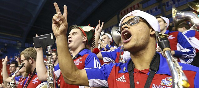 Holiday Hawks: Wearing a holiday-themed hat, Andre Womack, a saxophonist with the Kansas basketball band, counts down as the band performs prior to tipoff against Omaha, on Monday, Dec. 18, 2017 at Allen Fieldhouse.