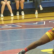LHS' Relle Dye stares down his opponent during a dual in Eudora.