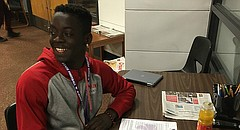 Lawrence High senior football standout Ekow Boye-Doe signs his letter of intent before school on Wednesday to play football at Kansas State.