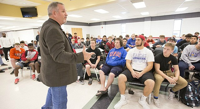 Newly-hired Lawrence High football coach Steve Rampy introduces himself to members of the football team on Wednesday, Dec. 20, 2017 in the school cafeteria. Rampy comes to Lawrence High from Pittsburg State, where he served as offensive coordinator for eight years.