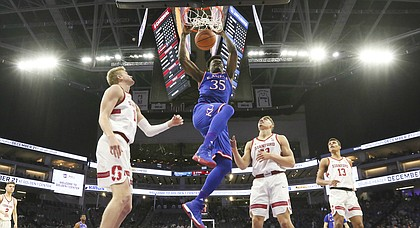 Kansas center Udoka Azubuike (35) delivers a dunk before the Stanford defense during the first half, Thursday, Dec. 21, 2017 at Golden 1 Center in Sacramento, California.
