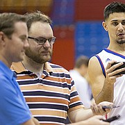 Kansas guard Sam Cunliffe tries to get a laugh out of Mitch Lightfoot while playing reporter during Media Day on Friday, Oct. 13, 2017 at Allen Fieldhouse. Members of the men's basketball team were available for photographs and interviews with various media outlets.