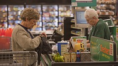 In this Journal-World file photo from October 2012, Delores Kaczor, of Lawrence, left, buys groceries at Checkers, 2300 Louisiana St., as cashier Betty Grems tallies the total. The Douglas County Food Policy Council has joined the long-standing fight to eliminate sales tax on groceries, and it wants local governments to back it up.