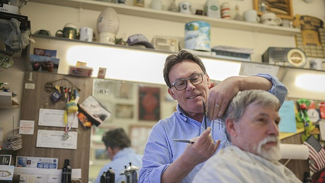 Lawrence City Commissioner Mike Amyx gives a customer a trim on Wednesday, Dec. 20, 2017 at Amyx Barber Shop, 842 Massachusetts St. Amyx has served in local government for 22 years, including six terms as mayor. His current term will end Jan. 8.