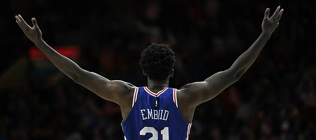 Philadelphia 76ers center Joel Embiid gestures to the crowd after being shoved by Utah Jazz's Donovan Mitchell during the second half of an NBA basketball game, Monday, Nov. 20, 2017, in Philadelphia. Mitchell was called for a technical foul on the play. Philadelphia won 107-86.