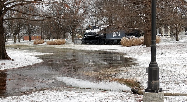 City crews use a fire hose to flood the bottom of Watson Park to make ice skating possible during the current cold spell. The National Weather Service says temperatures are expected to remain at or below freezing for the remainder of the week.
