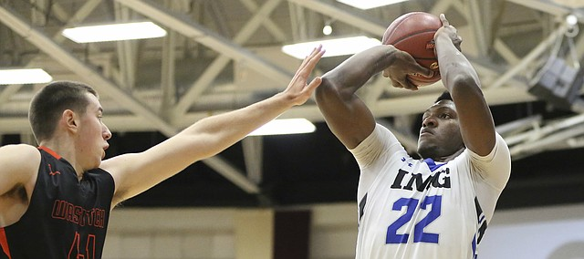 FILE — IMG Academy's Silvio De Sousa #22 in action against Wasatch Academy during a high school basketball game at the 2017 Hoophall Classic on Sunday, January 15, 2017, in Springfield, MA. De Sousa arrived at the University of Kansas this week to join the men's basketball team ahead of schedule.(AP Photo/Gregory Payan)
