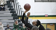 Lawrence High's Chisom Ajekwu puts up a shot against Shawnee Mission South Friday.