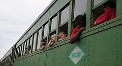 In this file photo from Sept. 13, 2008, riders peek out the window of a Midland Railway train in Baldwin City.