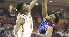 Texas forward Mohamed Bamba (4) rejects a shot from Kansas center Udoka Azubuike (35) during the first half on Friday, Dec. 29, 2017 at Frank Erwin Center in Austin, Texas.
