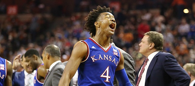 Kansas guard Devonte' Graham (4) lets out a roar during a break in action in the second half on Friday, Dec. 29, 2017 at Frank Erwin Center in Austin, Texas.
