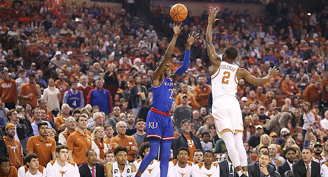 Kansas guard Lagerald Vick (2) puts up a three over Texas guard Matt Coleman (2) during the first half on Friday, Dec. 29, 2017 at Frank Erwin Center in Austin, Texas.