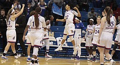 The Kansas women's basketball team celebrates its 86-77 win over TCU in its Big 12 home opener on Sunday at Allen Fieldhouse.