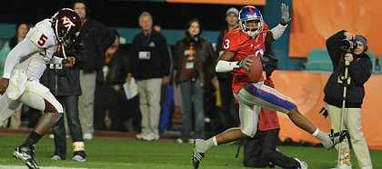 Kansas cornerback Aqib Talib high-steps into the end zone after picking off a pass during the first half as quarterback Tyrod Taylor (5) pursues. Talib was named MVP of the Jayhawks' 24-21 victory over Virginia Tech in the Orange Bowl on Thursday in Miami. Kansas University athletics officials have scheduled a free public event to celebrate the football team's Orange Bowl victory.