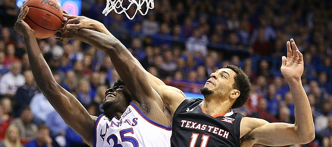 Kansas center Udoka Azubuike (35) is fouled on the shot by Texas Tech forward Zach Smith (11) during the first half, Tuesday, Jan. 2, 2018 at Allen Fieldhouse.