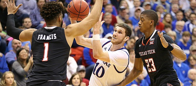 Kansas guard Sviatoslav Mykhailiuk (10) tries to squeeze between Texas Tech guard Brandone Francis (1) and Texas Tech guard Jarrett Culver (23) during the second half, Tuesday, Jan. 2, 2018 at Allen Fieldhouse.