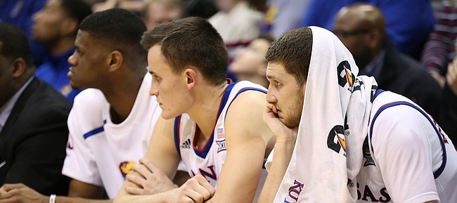 Kansas guard Sviatoslav Mykhailiuk, right, Kansas forward Mitch Lightfoot and forward Billy Preston watch the waning moments of the Jayhawks' 85-73 loss to Texas Tech, Tuesday, Jan. 2, 2018 at Allen Fieldhouse.