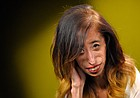 In this Monday, Aug. 24, 2015 photo, Lizzie Velasquez poses for a photo at the Associated Press bureau, in Los Angeles. (AP Photo/Mark J. Terrill)