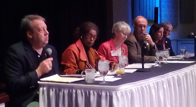 Sen. Tom Holland, left, D-Baldwin City, speaks to a Lawrence Chamber of Commerce audience during its annual Legislative Priorities Breakfast Friday. Also present from the Lawrence delegation are, from left: Rep, Barbara Ballard, Dem.; Sen. Marci Francisco, Dem.; Rep. Tom Sloan, Repub.; Rep. Eileen Horn, Dem.; and Rep. Boog Highberger, Dem.