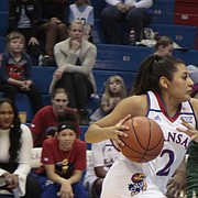 Kansas junior Brianna Osorio approaches the paint while Baylor junior Kalani Brown slides over to defend in the second half of the Jayhawks' 83-48 loss to the Bears on Saturday at Allen Fieldhouse.