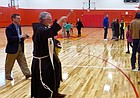 Pastor Jeffrey Ernst blesses the new gym at St. John the Evangelist Catholic Church as parish members check out the new 8,000-square-foot facility on Sunday, Jan. 7, 2018. The gym in the 1200 block of Kentucky Street will serve St. John Parish and School.